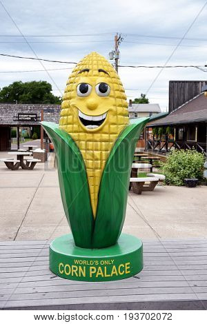 MITCHELL, SOUTH DAKOTA - JUNE 22, 2017: The Corn Palace Corn Statue. Built in 1892 as a way for farmers to display their bounty. It is annually covered with new murals.