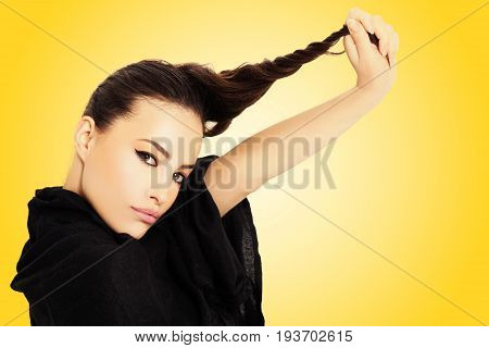 young beauty pulls her hair and make unicorn horn