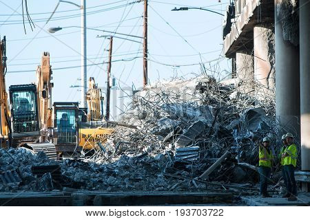 ATLANTA, GA - APRIL 2017:  A huge pile of debris sits where a section of I-85 South was imploded and knocked down following the collapse of the I-85 North bridge from a fire in Atlanta GA on April 1 2017.