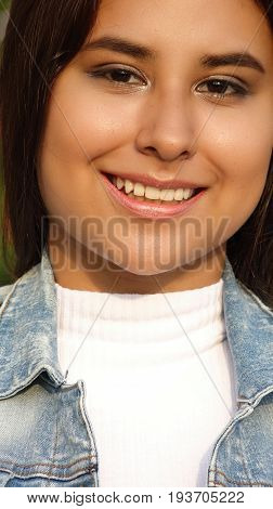 Headshot Portrait of a Hispanic Girl Teen
