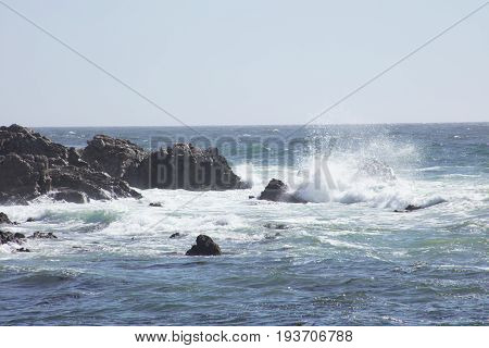 View of Waves Crash on rocks  along 17 mile drive Pebble Beach California