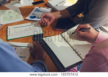 Business And Finance Concept Of Office Working, Businessmen Discussing Analysis Chart And Using Calc