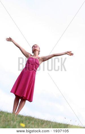 Woman Standing On Grass