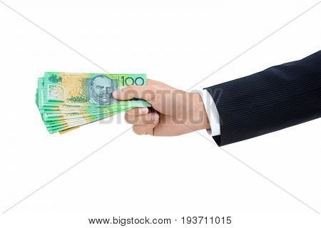 Hand of businessman giving money Australian dollar (AUD) banknotes on white background