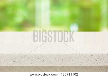 White quartz stone countertop on blur green background - can be used for display or montage your products