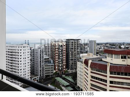 City apartment living in Auckland New Zealand NZ - high-rise flats office and hotels viewed from a balcony