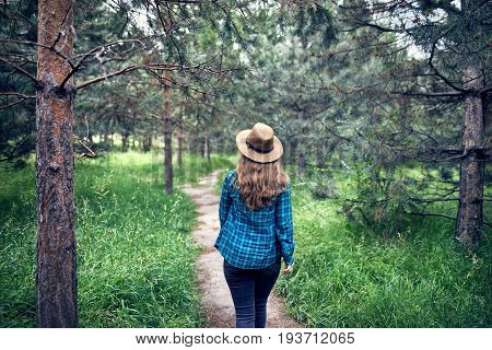 Beautiful Woman Walking In The Forest