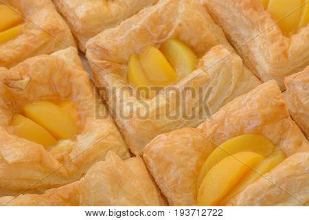 Peach slice strudel pastries in bakery box