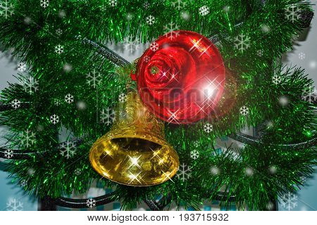 Background for cards for Christmas. Glass bell toy, snowflakes Christmas, Christmas decorations on green spruce branch.