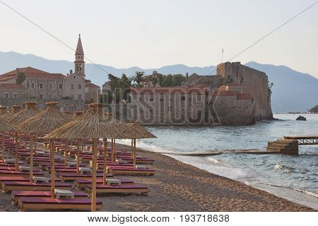 Deserted beach near the Old Town of Budva in the morning
