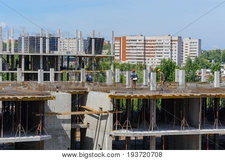 June 30 2017: Photo of workers on the construction of a multi-storey residential house. Cheboksary. Russia.
