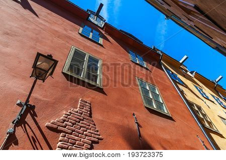Stockholm. Old Red House Facade With Street Lamp