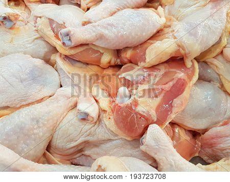 fresh raw chicken thigh sold in supermarket
