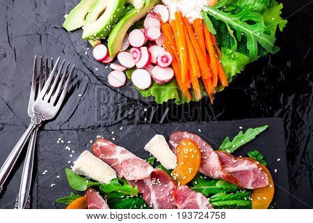Two Different Salads Om Black Stone Slate. Vegan Salad. Meat Salad. Salad With Ham Jamon Serrano, Ca