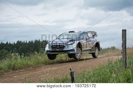 MIKOLAJKI, POLAND - JUL 1: Ott Tanak and his codriverMartin Jarveoja  in aFord Fiesta WRC race in the 74nd Rally Poland, on July 2, 2017 in Mikolajki, Poland.