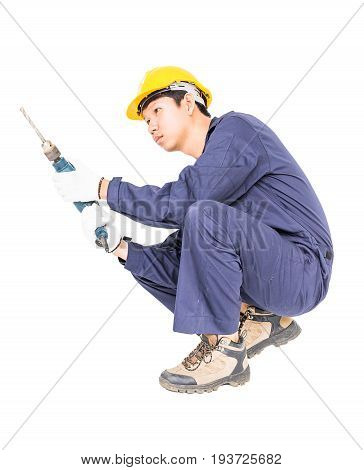 Handyman In Unifrom Sitting With His Electric Drill