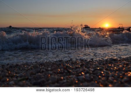 Summer sunset scene from the beach whit wave sea