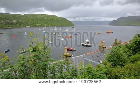 View of Portree Bay from Portree with traditional slate roofs in the foreground, Isle of Skye, Highlands, Scotland, UK