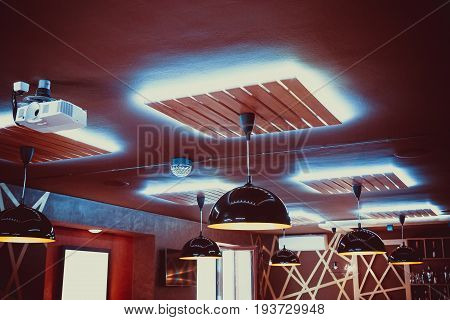 Beautiful Interior Restaurant With Luxury Chandeliers And Evening Lighting. Background Of The Ceilin