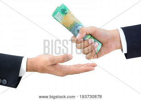 Hands of businessmen passing money Australian dollars (AUD) isolated on white background
