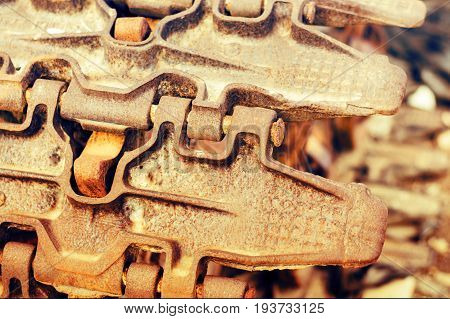 Continuous Caterpillar Tracks Of The Bulldozer. Close Up. Detail Of A Rusty Tractor Tracks.