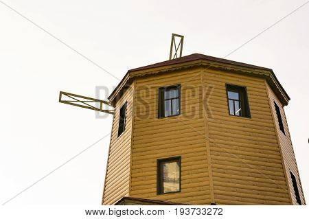 rustic old wooden windmill against the sky.