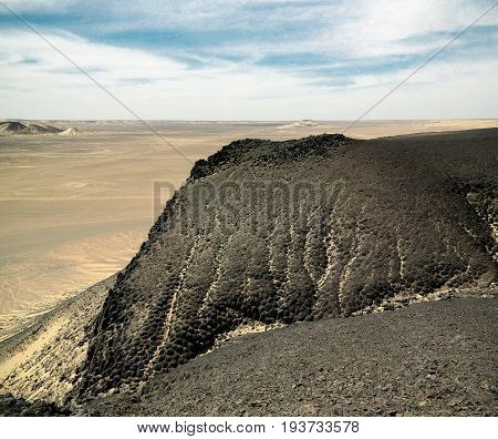 Mountain landscape in Black Desert near Bahariya oasis Egypt