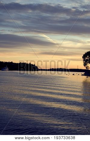 Fantastic day in the archipelago, Sweden. Beautiful summer season specific photograph. Summer archipelago with beautiful sunlights and marine environment. Lovely lights and colors. Summer environment.