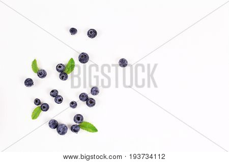 Fresh blueberry with leaf on white background