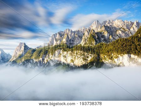 Stunning image of alpine lake Vorderer Gosausee. Picturesque and gorgeous morning scene. Salzkammergut is a located in the Gosau Valley in Upper Austria. Dachstein glacier. Explore the world's beauty.