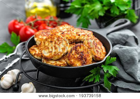 Chicken meat cutlets on black background, close up