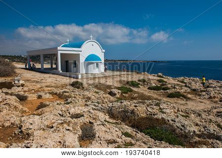 Tourists And Pilgrims Visiting The Agioi Anargyroi Chapel Situated In Cape Greco, Cyprus Island