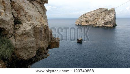 Alghero - Sardinia (Italy). Neptune's Cave - Panoramic shot of Foradada Isle view from Escala del Cabirol