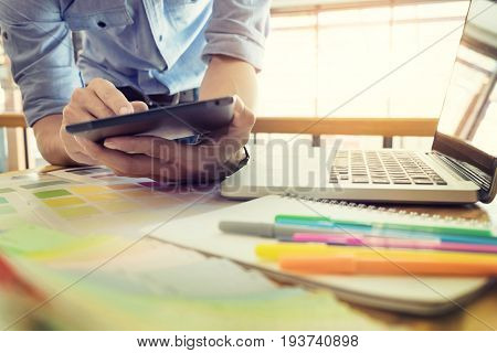 Hands Of Female Hipster Modern Graphic Designer In Office Working With Colour Samples. Woman At Work