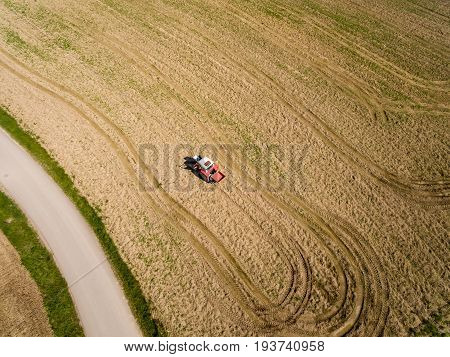 aerial view Tractor and Seeder a Field in summer