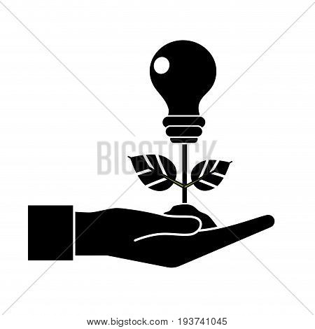 contour hand with energy bulb plant with leaves and ground vector illustration