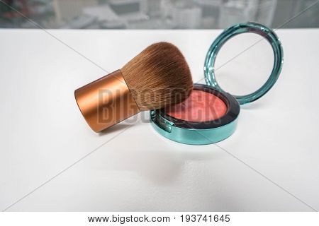 luxury gold cheek brush with pink red brush on