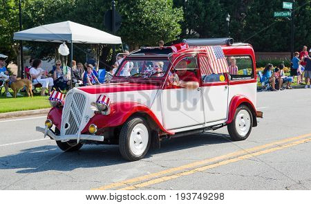 DUNWOODY GEORGIA - July 4 2016: Participants and spectators in the annual Dunwoody Georgia 4th of July parade which attracts over 2500 participants and 32000 spectators