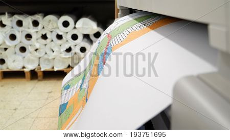 Jerusalem, Israel - May 21, 2017: Wide format printer is printing color design draft outline sketch drawing in the printing house. Design office supply equipment.