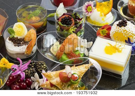 Canape desserts and snack in plastic cups