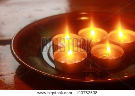 Holiday candles burning on table. funeral horizontal background