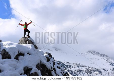 successful climb in the snowy mountains and cloudy
