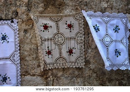 DUBROVNIK/CROATIA - 28 JUNE 2017: Typical Croatian hand made lace items exposed on Dubrovnik old town walls and on sale