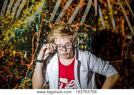 Funny Teenage Boy Posing Like A Crazy Professor Or Student