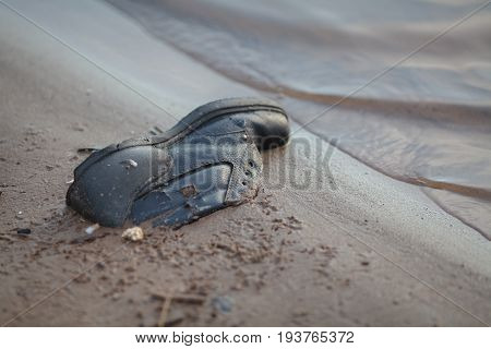 Dusty Old Shoe Abandoned On River Coat