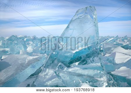Beautiful transparent blue ice blocks on sky background