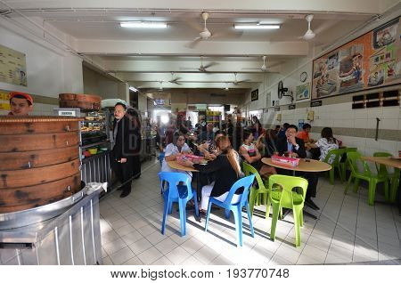 People Having Lunch At Street Eatery In Gaya Street Kota Kinabalu
