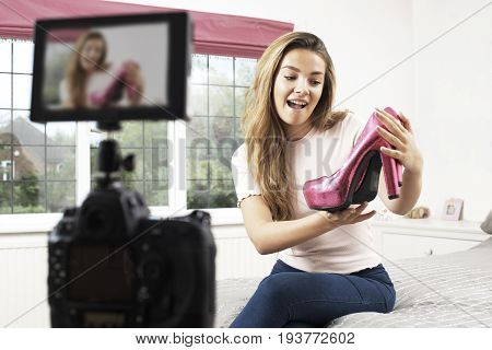 Female Vlogger Recording Fashion Broadcast In Bedroom