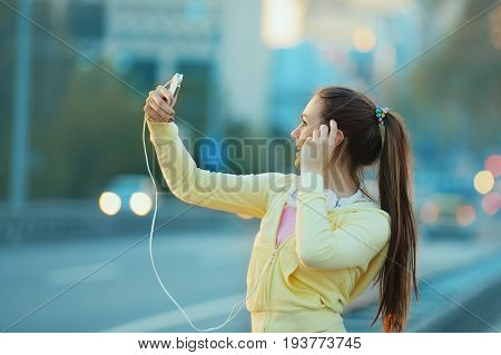 Beautiful Young Woman Using Cellphone After Exercising