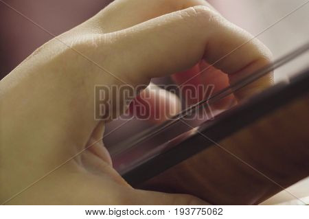 Close up of women's hands playing string instrument